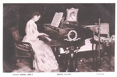 Gertie Millar playing a grand piano (image)
