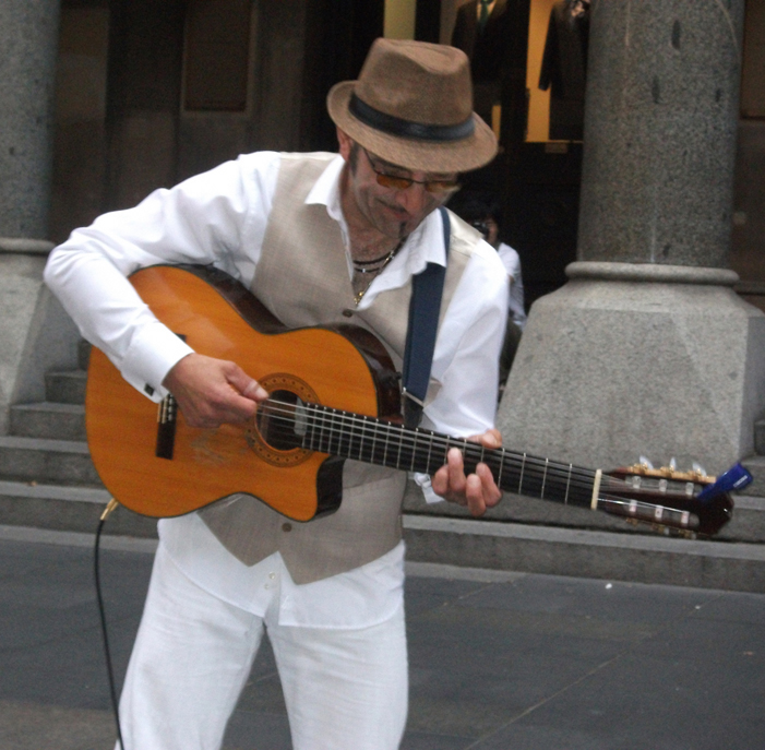 A guitarist and violinist from the Balkan Duo playing in Sydney, Australia (image)