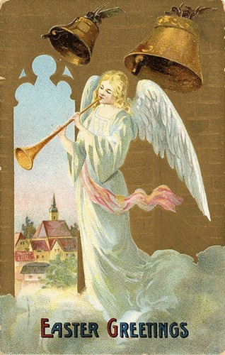 Angel blows a trumpet or horn (image)