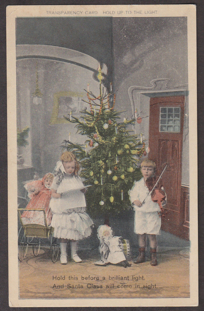 Christmas card with boy playing violin and girl singing (image)